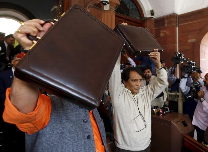 India's Railway Minister Suresh Prabhu holds up his briefcase upon his arrival at the parliament to present the railway budget in New Delhi, February 25, 2016. REUTERS/Adnan Abidi