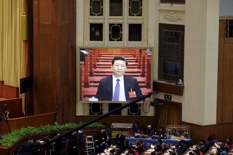 A screen shows China's President Xi Jinping during the opening session of the National People's Congress (NPC) at the Great Hall of the People, in Beijing, China, March 5, 2016. REUTERS/Jason Lee