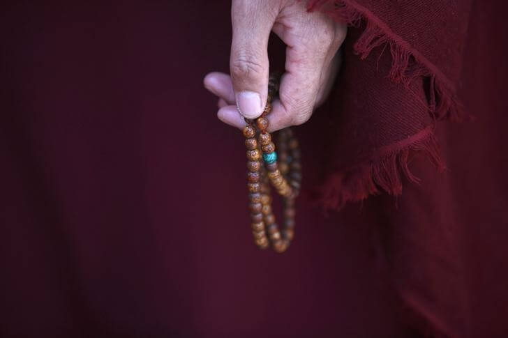 A Tibetan nun holds prayer beads during a function organised by the Tibetan Refugee Community in Nepal commemorating the 25th Anniversary of the Nobel Peace Prize conferment to exiled Tibetan spiritual leader Dalai Lama and the 66th International Human Rights Day in Kathmandu December 10, 2014. REUTERS/Navesh Chitrakar/Files