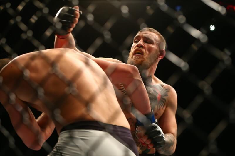 March 5, 2016; Las Vegas, NV, USA; Conor McGregor moves in for a punch against Nate Diaz during UFC 196 at MGM Grand Garden Arena. Mandatory Credit: Mark J. Rebilas-USA TODAY Sports