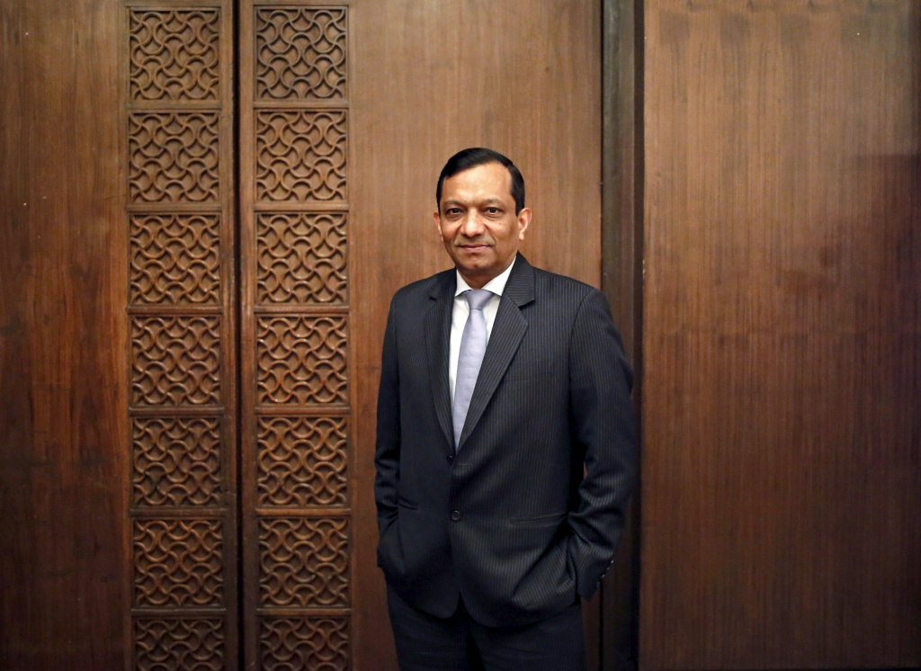 Pawan Goenka, president of Mahindra's automotive and farm equipment sectors, poses after his interview with Reuters in New Delhi in this September 11, 2014 file photo.  REUTERS/Anindito Mukherjee/Files