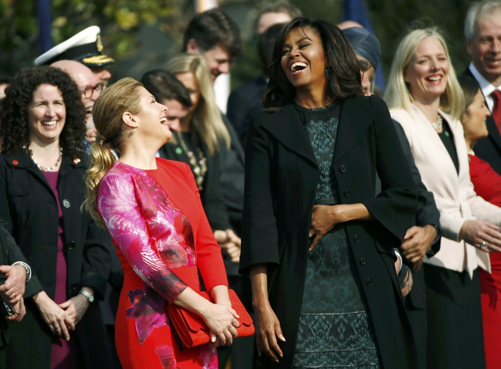 U.S. First lady Michelle Obama (R) and Sophie Gregoire Trudeau (L) laugh at the official arrival ceremony at the White House in Washington March 10, 2016. REUTERS/Kevin Lamarque