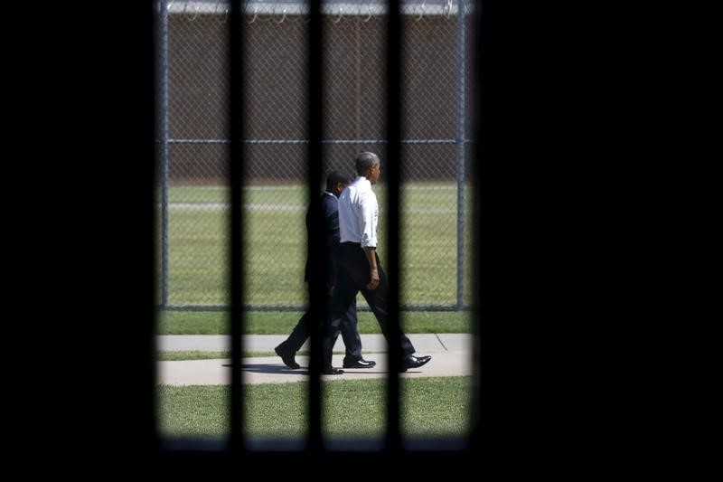 Photographed through a prison cell window, U.S. President Barack Obama tours the El Reno Federal Correctional Institution after Obama in El Reno, Oklahoma July 16, 2015.   REUTERS/Kevin Lamarque