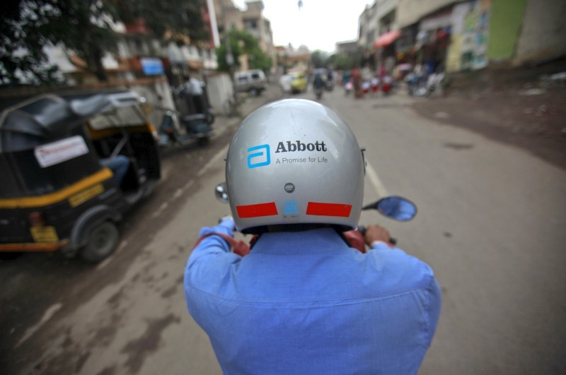 A representative for Abbott rides his motorcycle to a doctor's clinic in Pune, in this file picture taken August 27, 2012. REUTERS/Danish Siddiqui/Files