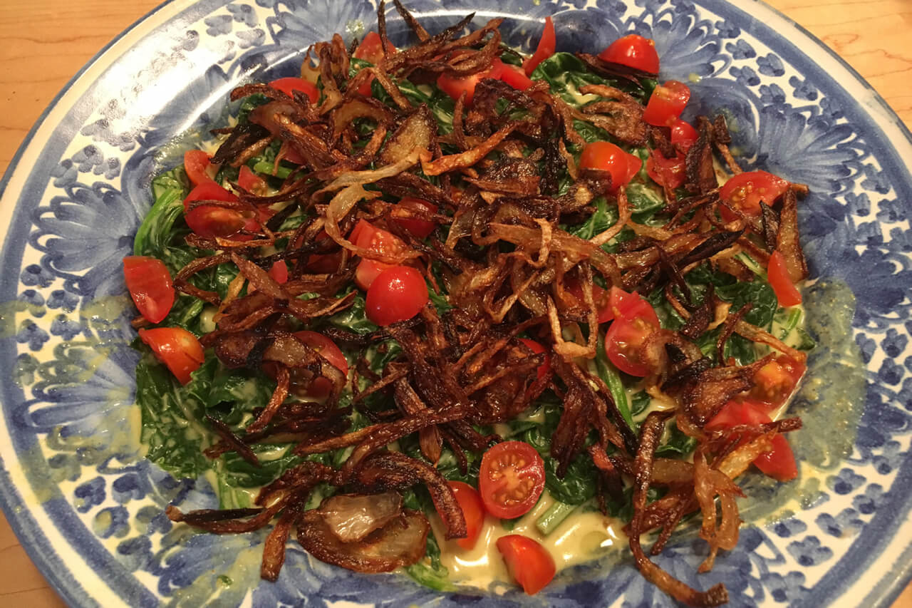 A New Delhi-style curried spinach has coconut milk, tomatoes and fried onions. Credit: Copyright 2016 Marie Simmons