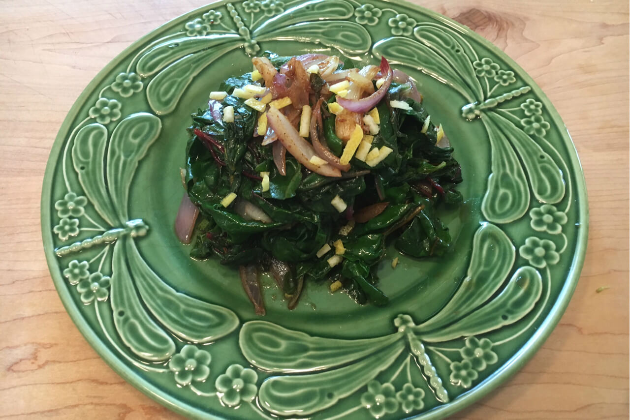 Moroccan greens are made with caramelized red onions, A Moroccan spice blend and preserved lemons. Credit: Copyright 2016 Marie Simmons