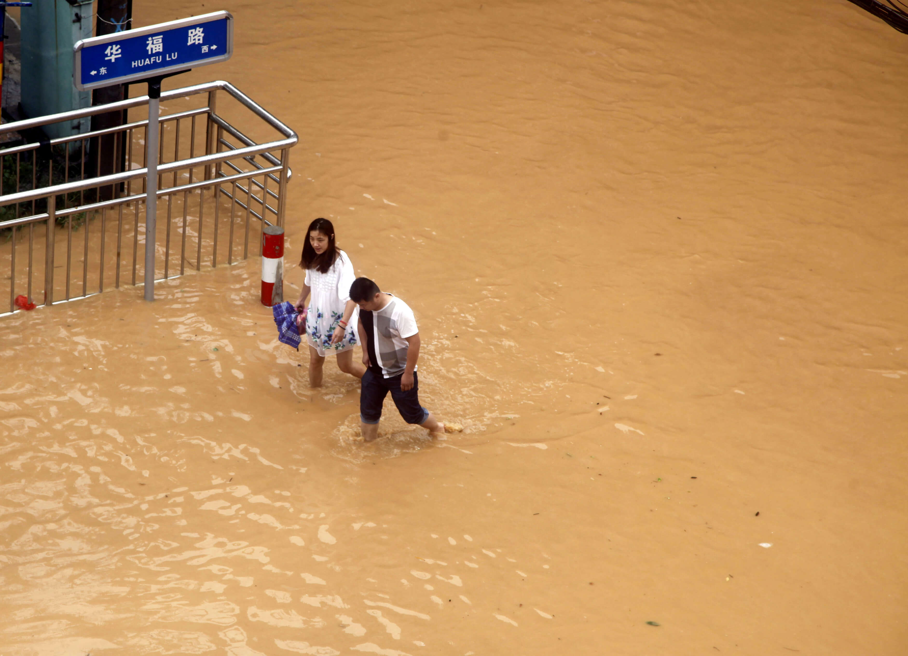 Residents walk at a flooded area as Typhoon Nepartak brings heavy rainfall in Putian, Fujian Province, China, July 9, 2016. REUTERS/Stringer