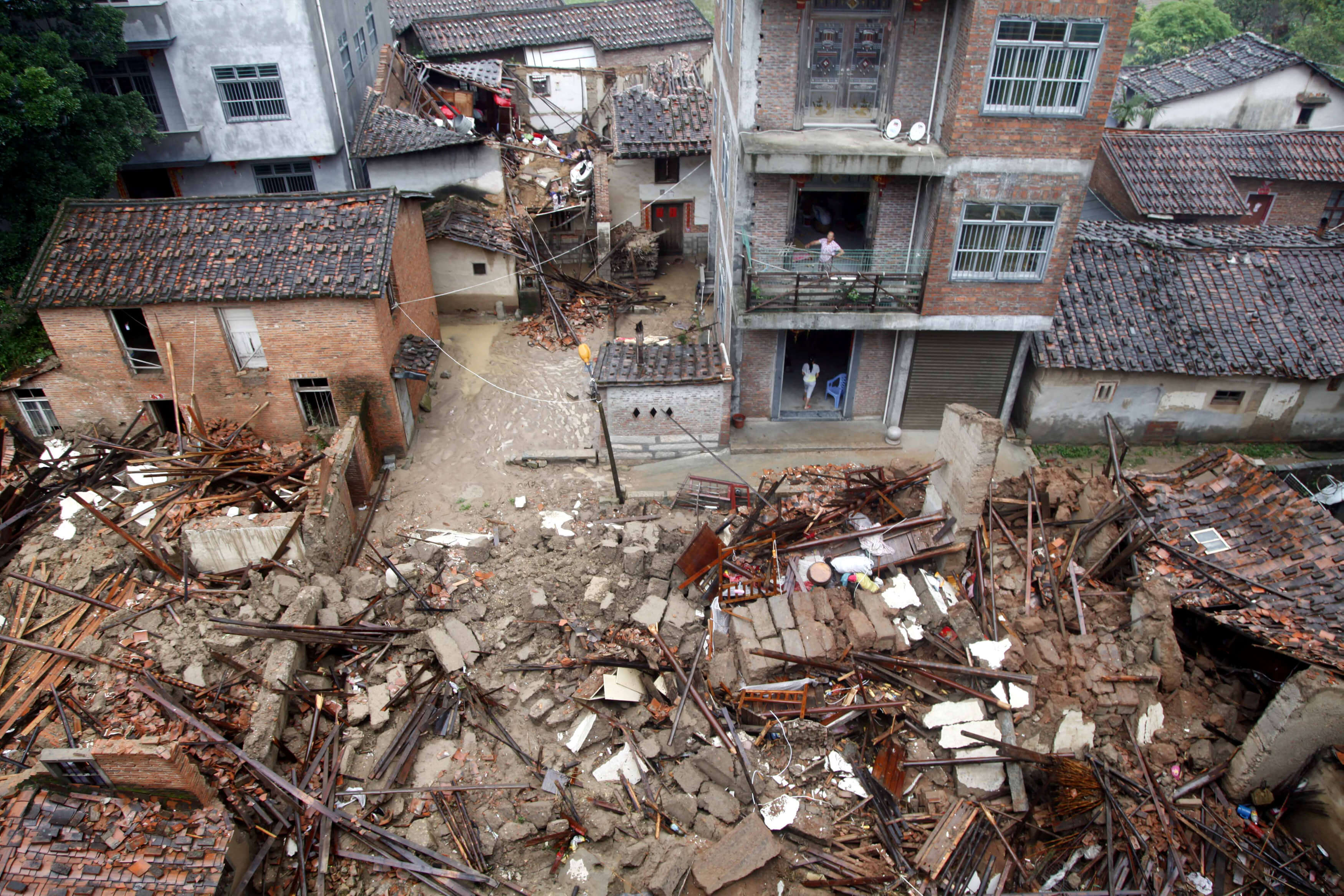 Damaged and collapsed buildings are seen as Typhoon Nepartak brings heavy rainfall in Putian, Fujian Province, China, July 9, 2016. REUTERS/Stringer